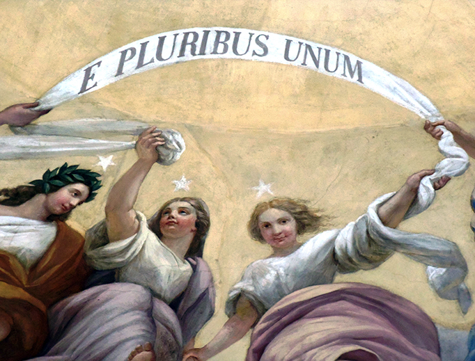 'E Pluribus Unum' banner detail on the dome of the United States Capitol in Washington, D.C.