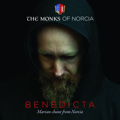 The monks' CD cover; Father Cassian Folsom, founder and prior of the monks of Norcia, addresses the crowd; Ross Douthat gives his address; a bottle and glass from the brewery of Norcia.
