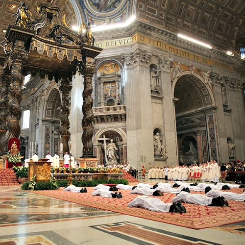 Nineteen men lie prostrate for their ordination as priests for the Diocese of Rome on April 26.
