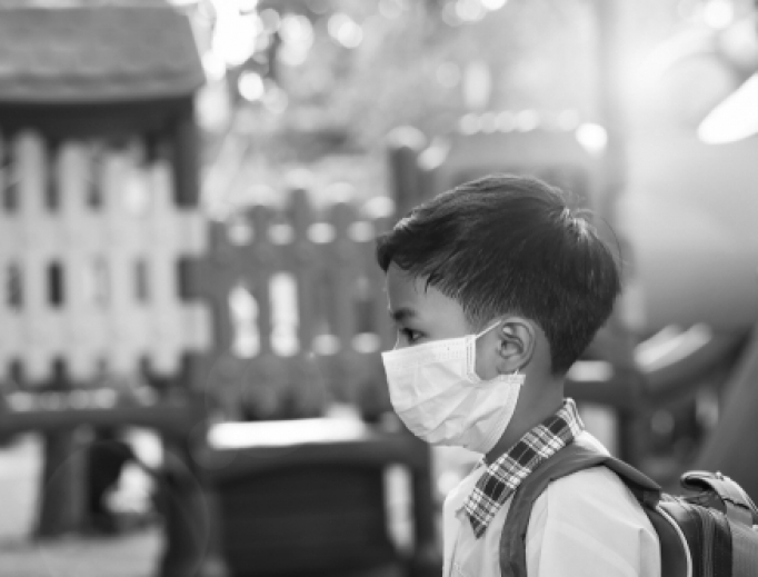 A 5-year old boy wears a face mask amid the coronavirus pandemic.