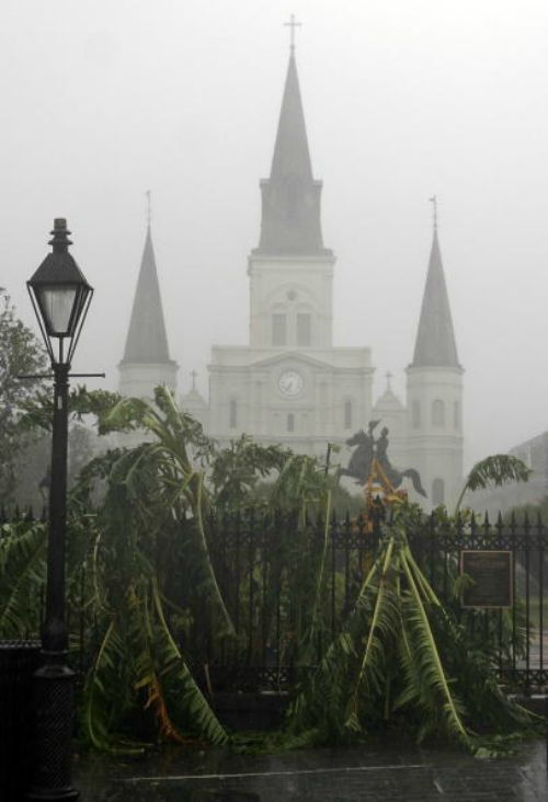 Trees are seen blown over in front of St. Louis Cathedral in New Orleans during Huricane Katrina on Aug. 29, 2005.