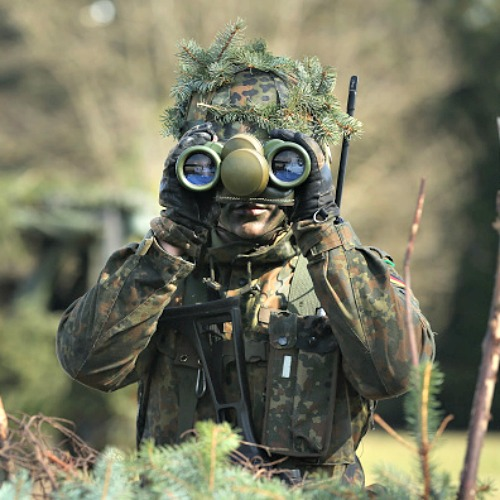 A member of the German Bundeswehr's 371st Armored Infantry Battalion looks through binoculaurs during a media event at the battalion's base on March 10 in Marienberg, Germany. NATO member states and many European nations are enhancing their military abilities as a reaction to Russian intervention in Ukraine.