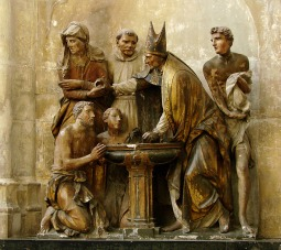 Sculpture in Troyes Cathedral of the baptism of St. Augustine.