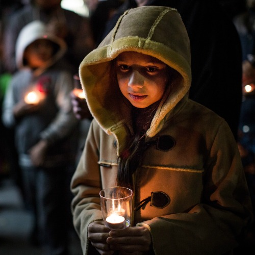 Warisha Umair, age 5, attends a candlelight vigil in Brooklyn for the 132 students killed in a Dec. 16 terror attack at the Army Public School in Peshawar, Pakistan.