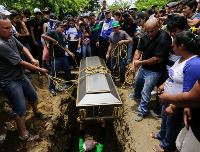 Friends and relatives bury the body of student Gerald Vasquez, who was shot dead during clashes with riot police in Divine Mercy Church in Managua, Nicaragua, July 16.