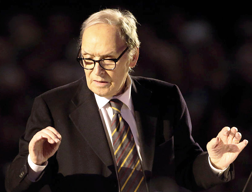 Ennio Morricone conducts an orchestra in the Paul VI Audience Hall at a concert on Nov. 12, 2016, at the Vatican.