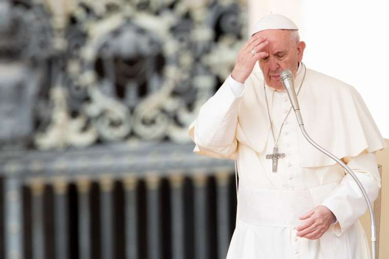 Pope Francis makes the Sign of the Cross April 18.
