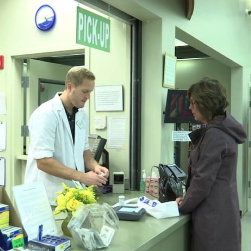 A pharmacist serves a customer at Ralph's Thriftway in Olympia, Wash.