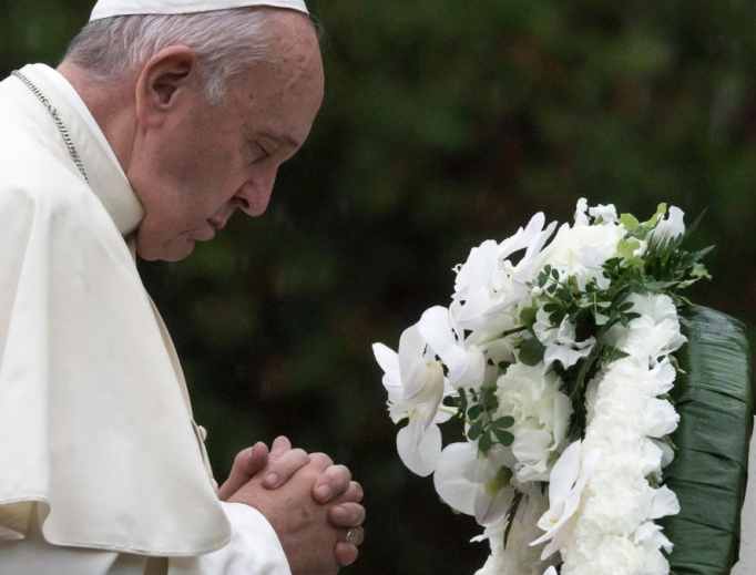 Pope Francis prays after laying a wreath at the Hypocenter Cenotaph at the Atomic Bomb Hypocenter Park on Nov. 24 in Nagasaki, Japan.