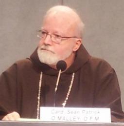 Cardinal Sean O'Malley of Boston addresses a Dec. 5 press conference in the Vatican.