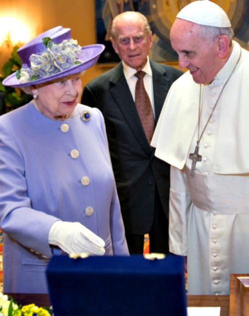 Queen Elizabeth II and Prince Philip, the Duke of Edinburgh, exchange gifts during an audience with Pope Francis, in the Pope's study during their one-day visit to Rome on April 3.