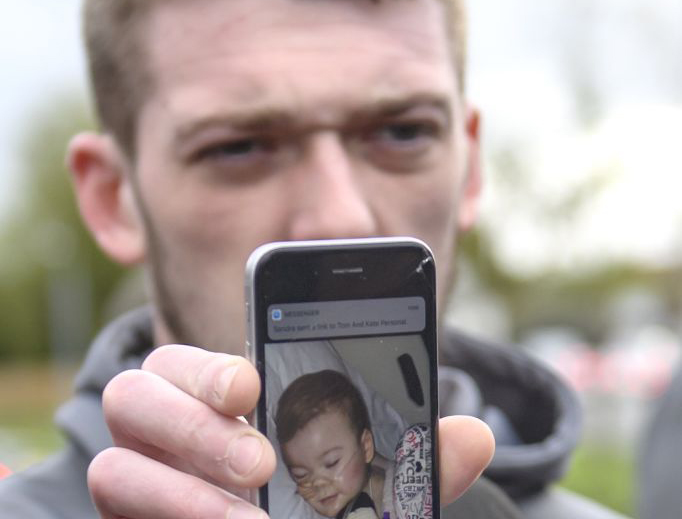 Tom Evans, Father of Alfie Evans, holds a photograph of his son as he speaks to media outside Alder Hey Children's Hospital on April 26, 2018 in Liverpool, England.