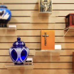 CREMATION RULES. A selection of urns are seen on display in the mortuary at Queen of Heaven Cemetery in Lafayette, Calif. While cremation is not prohibited unless it is chosen for reasons 'contrary to Christian teaching,' the Catholic Church prefers that the body of a deceased person be buried in accord with Church custom, according to statements issued by two U.S. archdioceses.