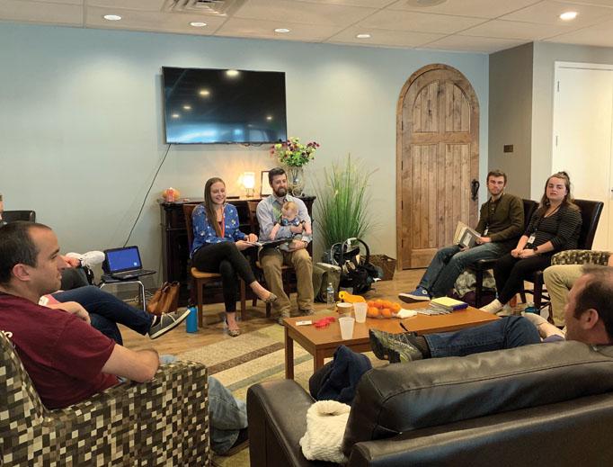 The Bigelow family addresses new-parent participants in Denver.