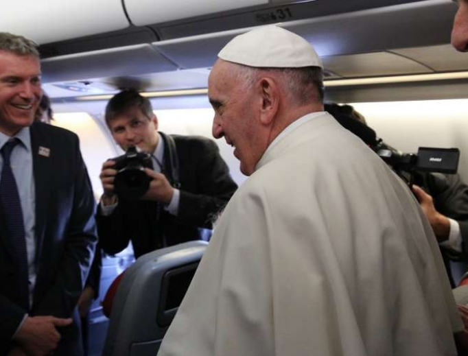 Pope Francis and Matteo Bruni aboard the papal flight to Cuba Feb. 12, 2016.
