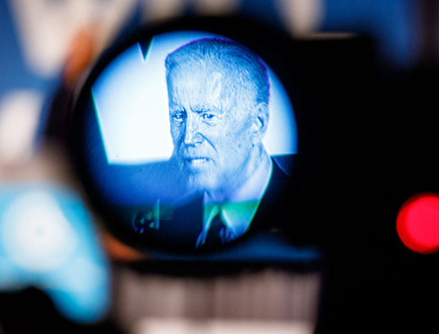 Former vice president and 2020 Democratic presidential candidate Joe Biden, seen through a news camera viewfinder, speaks to a crowd at a Democratic National Committee event June 6, 2019, in Atlanta, Georgia.