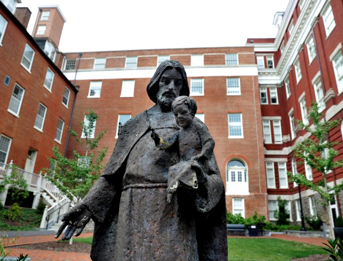 A Jesuit statue is seen in front of Freedom Hall, formerly named Mulledy Hall, on the Georgetown University campus on Sept. 1 in Washington. After renaming the Mulledy and McSherry buildings at Georgetown University temporarily Freedom Hall and Remembrance Hall, Georgetown University will give preference in admissions to the descendants of slaves owned by the Maryland Jesuits as part of its effort to atone for profiting from the sale of enslaved people.