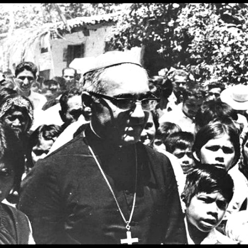 Archbishop Oscar Romero meets with young people in El Salvador in this undated file photo.