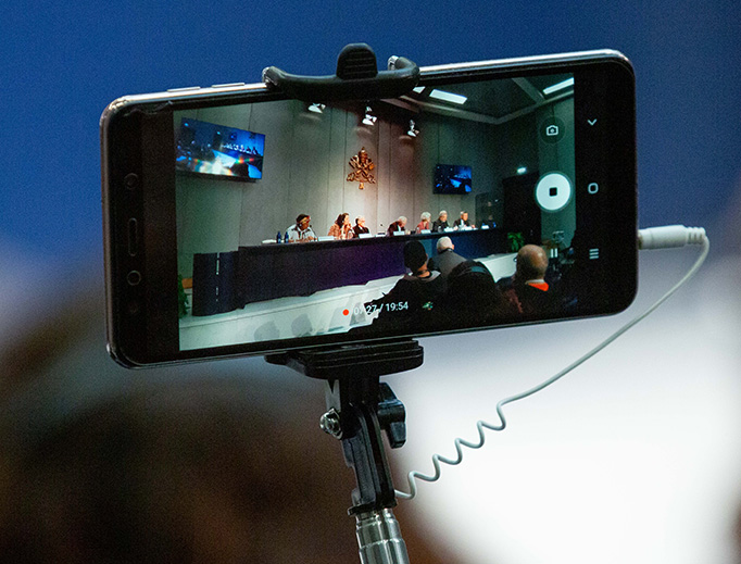 The Oct. 14 Pan-Amazon Synod media conference is seen through a smartphone viewfinder