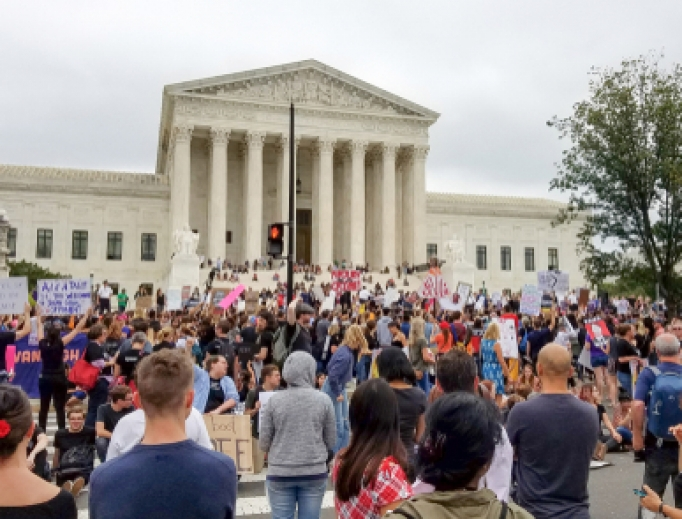 A crowd rallies at the Supreme Court to protest the nomination and the Senate vote for the next Associate Justice October 6, 2018.