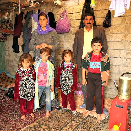 A family at the Sharia Al Haman Hope Refugee Camp in Duhok, Iraq, on March 28.