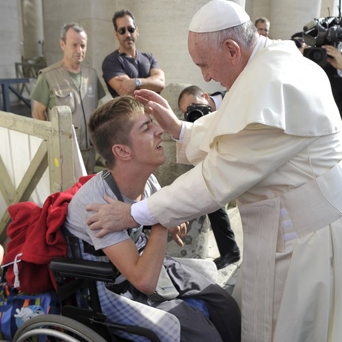 Pope Francis blesses a young  man with disabilities at a Wednesday general audience in St. Peter's Square in September 2015.