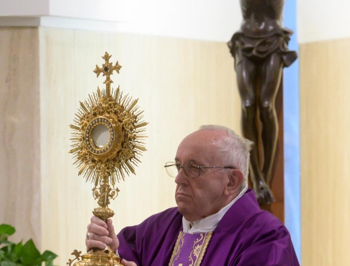 Pope Francis invites the faithful into Eucharistic Adoration after Mass, March 17, 2020.