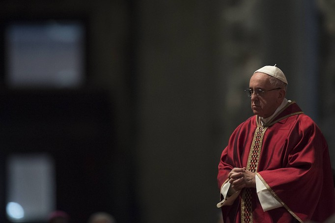 Pope Francis celebrates Good Friday with the veneration of the cross at St. Peter's Basilica on March 25, 2016.