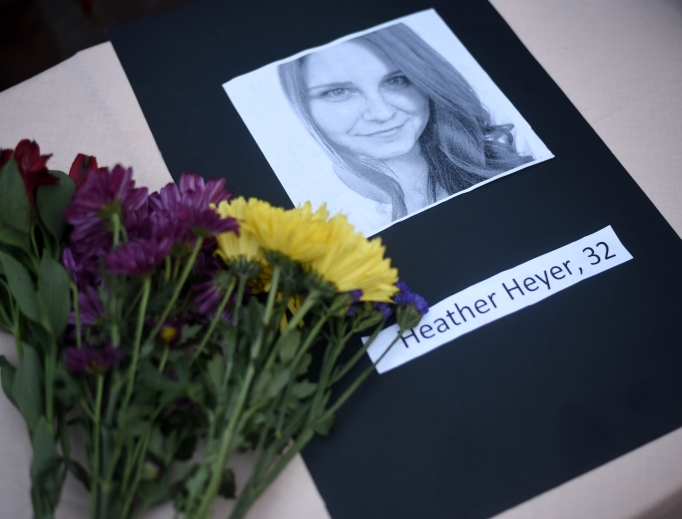 A portrait of Heather Heyer, who was killed when a vehicle drove through counterprotesters in Charlottesville, Virginia, lies on a table with flowers during a vigil on the campus of the University of Southern Mississippi in Hattiesburg Aug. 14. The rally was held in response to a white nationalist rally held in Charlottesville over the weekend.