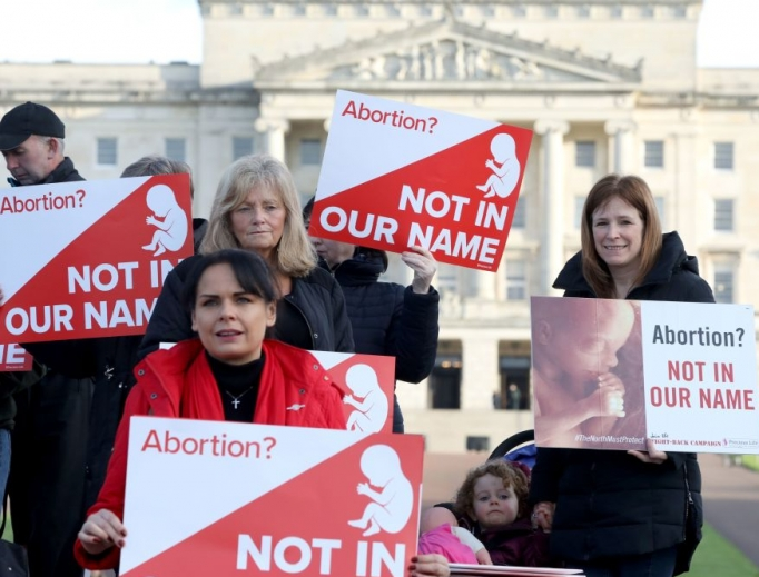 Pro-life campaigners gather with placards at Parliament buildings on the Stormont Estate in Belfast Oct. 21.