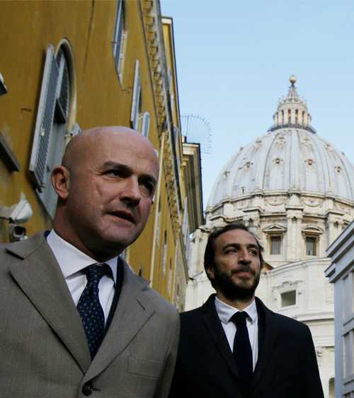 Italian journalists Gianluigi Nuzzi (l) and Emiliano Fittipaldi leave Vatican City on Nov. 24, after their appearance in a Vatican courtroom.