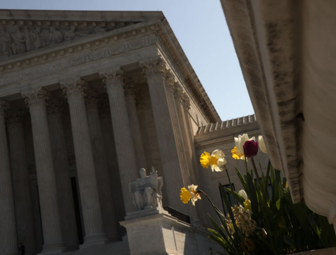 Spring flowers bloom in front of the U.S. Supreme Court April 6 in Washington. The Supreme Court announced that it has postponed oral arguments in light of COVID-19.