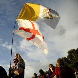DISPENSING WITH AN ANCIENT BIAS. Pilgrims wave the flags of England and the Vatican as they wait for a prayer vigil led by Pope Benedict during his 2010 visit. The British government did away with its more than 300-year-old law that stated that a member of the royal family would lose his place in the line of succession if he married a Catholic.