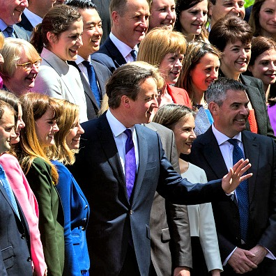 British Prime Minister David Cameron (c) poses for a picture with the new Conservative Party MPs in Palace Yard on May 11 in London.