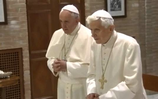 Pope Emeritus Benedict XVI and Pope Francis praying together in the Mater Ecclesiae Chapel, Dec. 23, 2013.