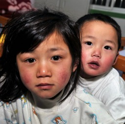 Two children are seen at a rescue station after their were rescued by police on Feb. 13, 2011, in Guiyang, Guizhou province of China. More than 9,300 kidnapped children in China have been rescued since April 2009 since a nationwide campaign was launched to crack down on human trafficking. In less than three weeks, a Chinese microblog called 'Street Photos to Rescue Child Beggars' attracted 175,000 followers and posted more than 2,500 images of begging children online for parents to identify. But agencies such as one run by the U.S. bishops conference might not be able to help such children if they lose goverment grants due to restrictions on religious liberty.