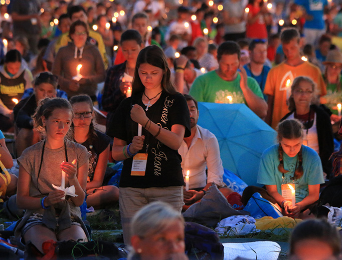 Pilgrims gather at the Prayer Vigil at Campus Misericordiae in Krakow, Poland for World Youth Day in 2016