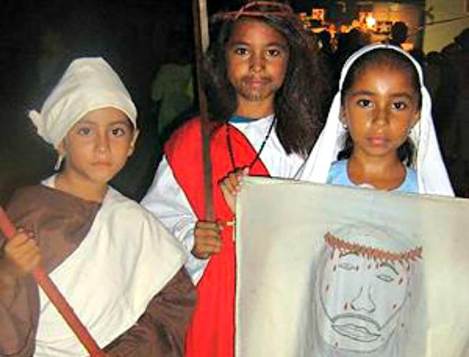 Three Belizean children dress as their favorite saints for Halloween.
