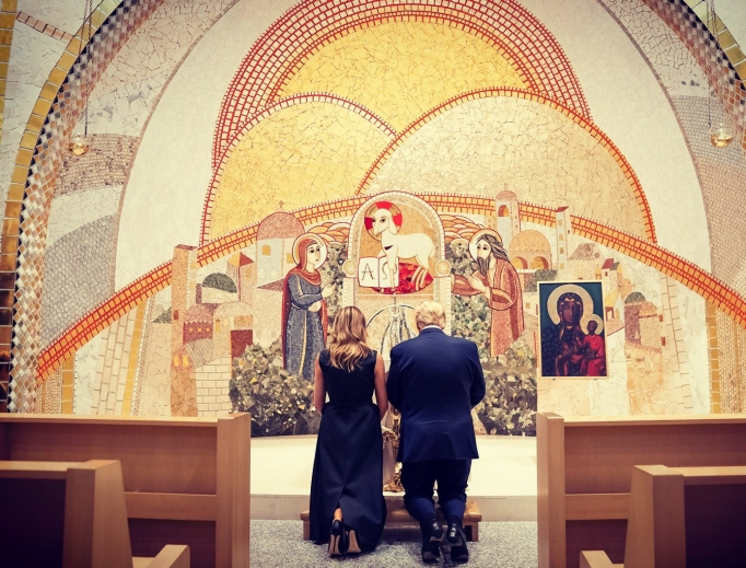 President Donald Trump and first lady Melania Trump kneel in front of a first-class relic of St. John Paul II at the St. John Paul II National Shrine on June 2.
