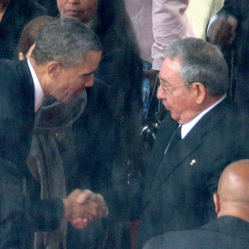 President Barack Obama greets Cuban President Raul Castro during the official memorial service for Nelson Mandela on Dec. 10, 2013, in Johannesburg, South Africa.