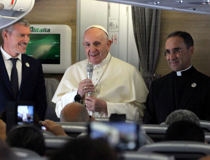 Pope Francis speaks during a press conference with journalist aboard the papal flight from Rome to Maputo, Mozambique, Sept. 4, 2019.