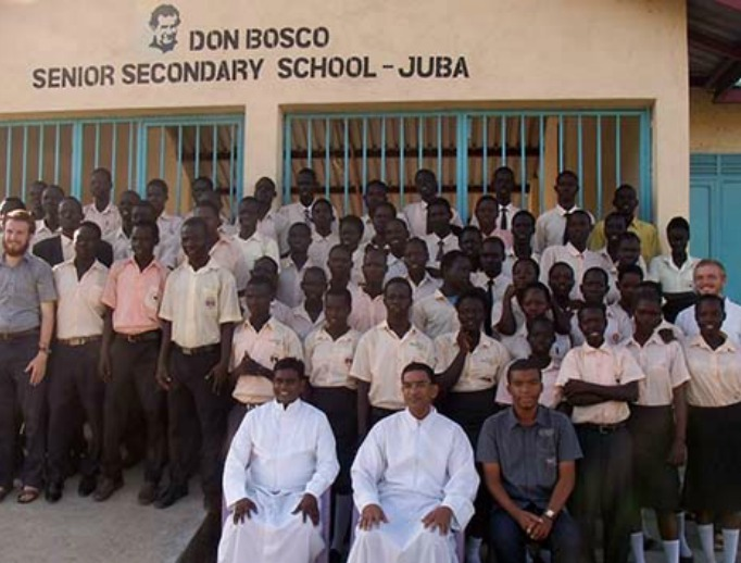 Top to bottom: 1, Salesian priests and lay missionaries operate Don Bosco Gumbo which comprises a parish, secondary school and youth center; 2, CRS staff help with a food drop to internally displaced refugees; 3, South Sudanese dance commemorating the nation's independence on July 9, 2011; 4,  Yar Wadok, mother of 5, with her youngest, 3 week-old Akou Marial.