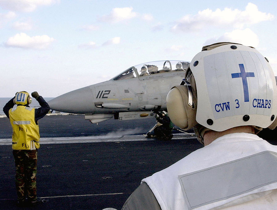The Carrier Airwing Three (CVW-3) chaplain stands behind the 'foul line' observing the launch of an F-14 Tomcat from the flight deck of USS Harry S. Truman (CVN 75) during Operation Iraqi Freedom, March 22, 2003.