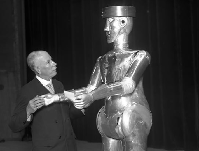 George the humanoid robot from the 1930s was constructed by motor engineer Alan Herbert Reffell and Captain W. H. Richards. Captain and journalist William H. Richards was secretary of the Exhibition of the Society of Model Engineers. The picture shows W. H. Richards and the Robot.