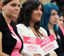 Women's rights activists listen during a Capitol Hill news conference July 11 that House Democratic leaders held to discuss the Republican-led repeal vote of the Affordable Care Act.