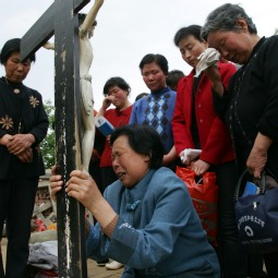 Catholics pray at the Cross Hill at Paowo Village in 2007 in Meixian County of Shaanxi Province, China. Cross Hill is a holy place first built by missionary Liu Jialu as a simulation of Calvary.