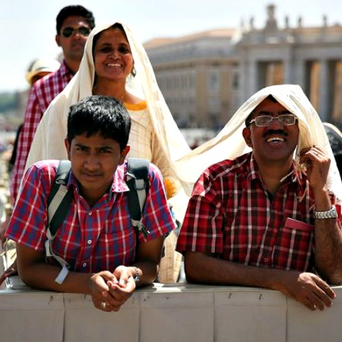 A family at the Pope's general audience in St. Peter's Square, May 13.