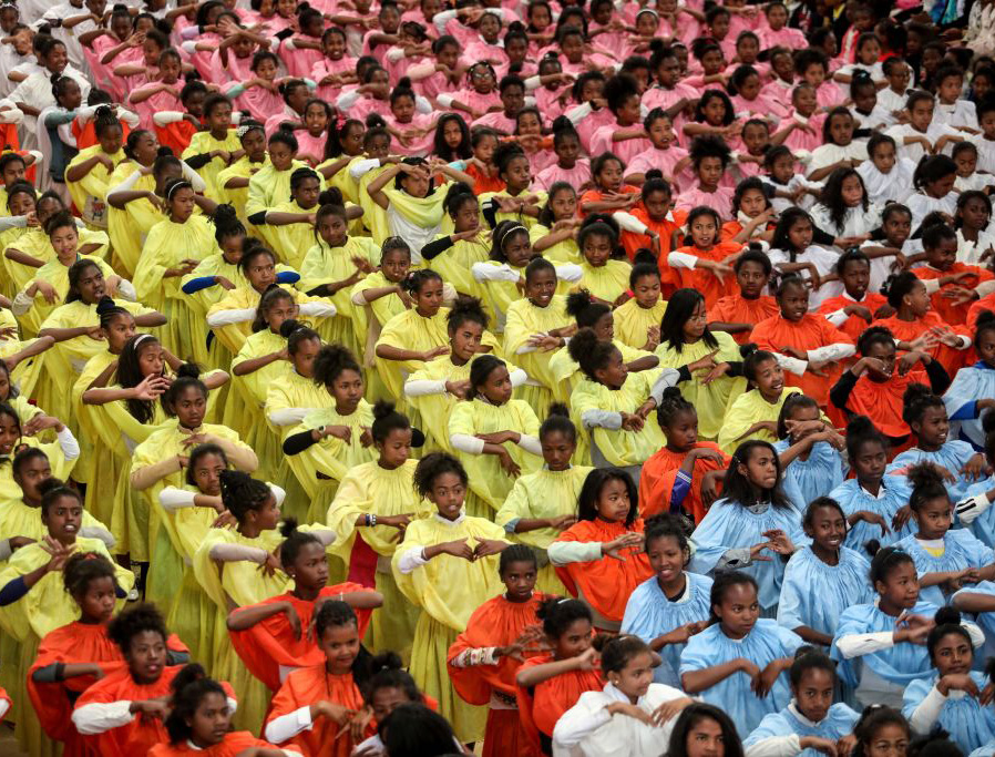Young people wait to greet Pope Francis in Antananarivo, Madagascar, on Sept. 8, 2019.