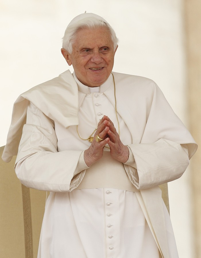 Pope Benedict XVI looks out on the crowd during his general audience in St. Peter's Square at the Vatican April 14.
