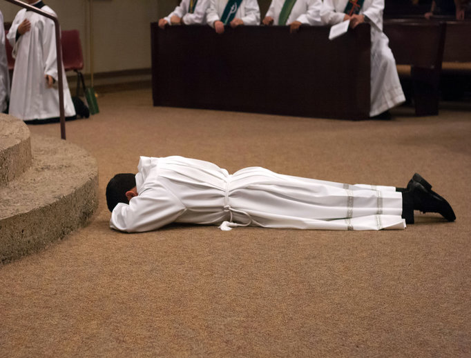 DEDICATED TO GOD. Deacon Frank Cicero lays prostrate before God, hugs Bishop Thomas Olmsted of Phoenix and shares the joy of his ordination with his mother, Olga.